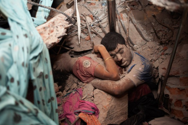 April 25, 2013. Two victims amid the rubble of a garment factory building collapse in Savar, near Dhaka, Bangladesh. Read more: http://lightbox.time.com/2013/05/08/a-final-embrace-the-most-haunting-photograph-from-bangladesh/#ixzz2SlWRG3gY